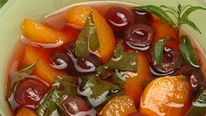 Poached fruit in lemon verbena syrup