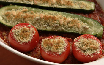 Garlic and herb-stuffed tomatoes and zucchini