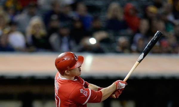 Angels left fielder Mike Trout hits a two-run home run during the team's 12-1 win over the Oakland Athletics.