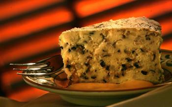 Potato timballo with fonduta (cheese sauce)
