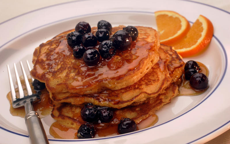Malted cornmeal pancakes with orange-blueberry syrup