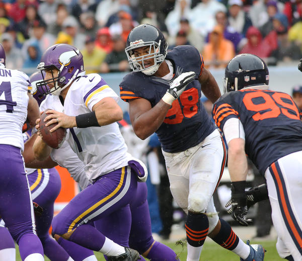 Corey Wooten chases after Vikings quarterback Christian Ponder in the first quarter.