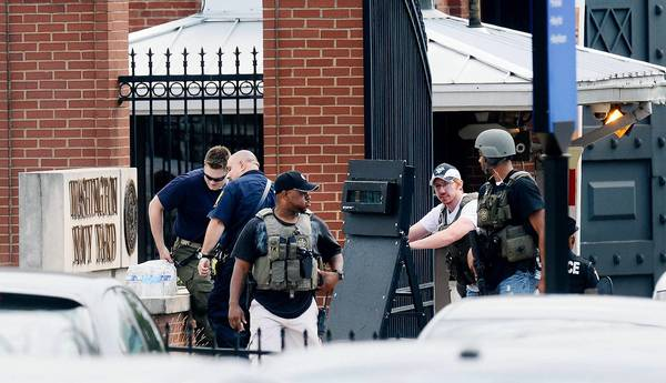 Law enforcement personnel respond to an attack on office workers at Washington Navy Yard Monday morning. A gunmen opened fire and killed 12 people in the attack in Washington, D.C.