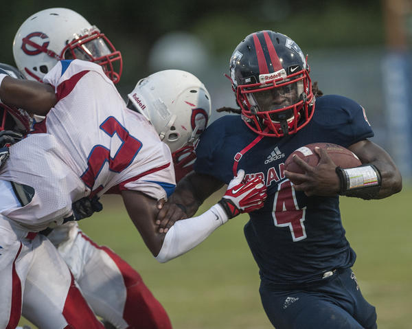 Miramar's Eric Pittman breaks through the arm tackle of Plantation's Daquon Irvin.
