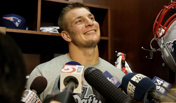New England tight end Rob Gronkowski talks to reporters.