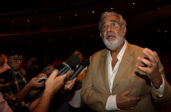 Placido Domingo talks to the press at the Dorothy Chandler Pavilion on Monday afternoon.
