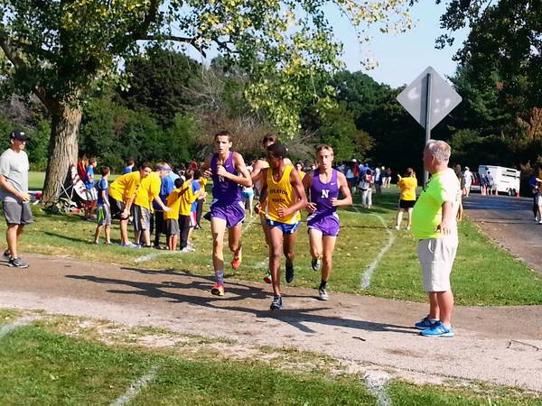 Downers Grove North runners Ryan Clevenger (left) and Zack Smith compete for a talented team