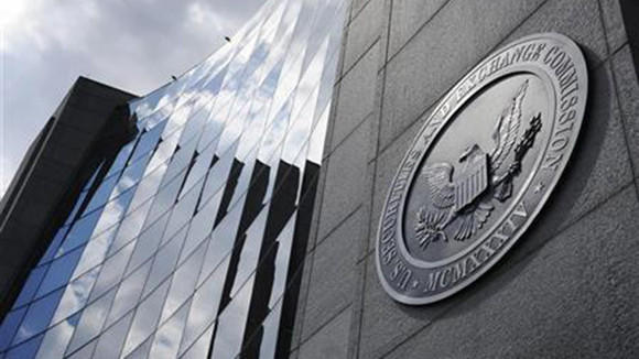 22 investment firms, including one based in Chicago, will collectively pay more than $14.4 million in sanctions to settle civil charges in connection with a broad crackdown by federal regulators into illegal short-selling practices.