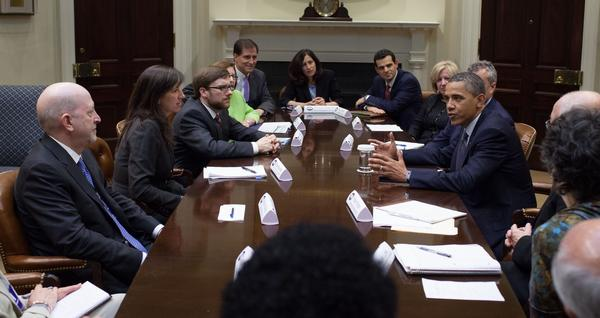 IRS Chief Counsel William Wilkins sits across from President Obama during a meeting with assistant secretaries in the White House.
