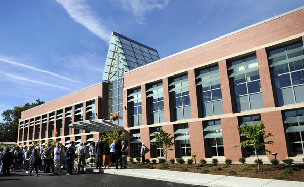 Students and staff head into The new Gallaudet-Clerc Education Center building at the American School for the Deaf for its first day of classes.