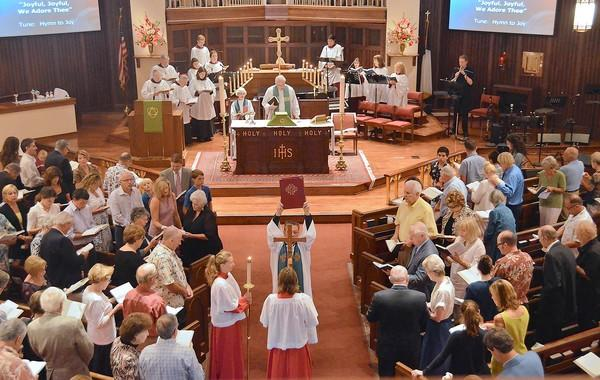 The Rev. Richard Crocker at the pulpit, gives thanks for the past 70 years of the ministry at St. James Anglican Church in Newport Beach. The church held its final service Sunday before having to hand the property over to the Episcopal Diocese of Los Angeles.