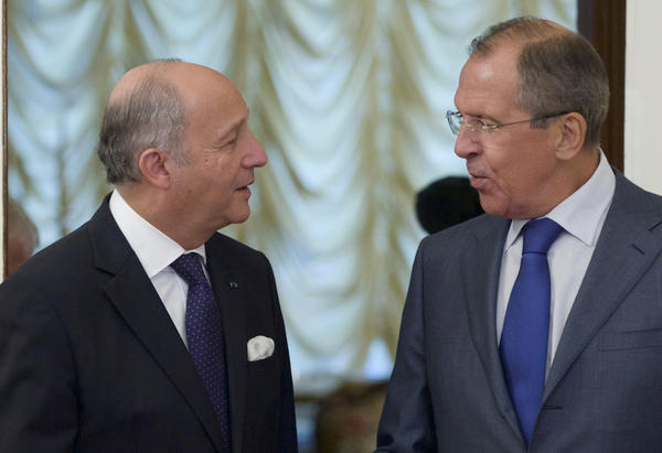 Russian Foreign Minister Sergei Lavrov, right, greets his French counterpart, Laurent Fabius, before a meeting in Moscow.