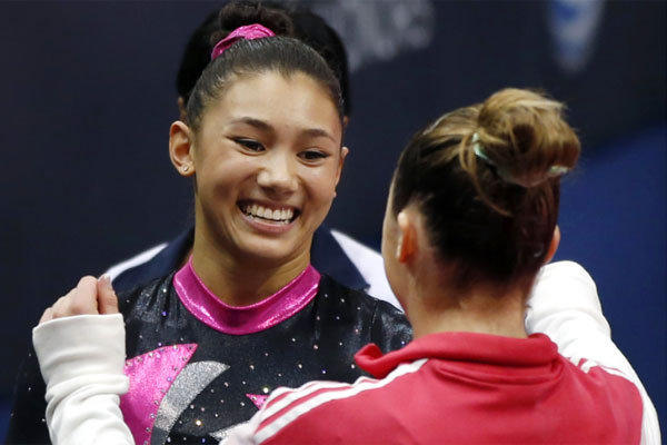 Kyla Ross, left, receives a hug from McKayla Maroney after the first round of the U.S. women's national gymnastics championships in Hartford, Conn., in August.