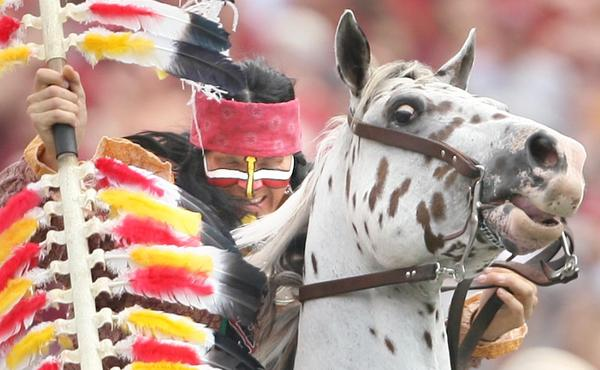 Chief Osceola struggles with a difficult maneuver as he rides Renegade during the Nevada at Florida State University football game at Doak Campbell Stadium in Tallahassee, Florida, on Saturday, September 14, 2013. FSU won the game 62-7.