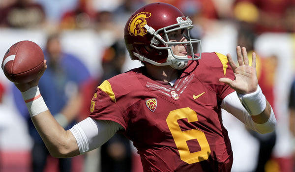 USC quarterback Cody Kessler completed 15 of 17 passes for 237 yards and two touchdowns in the Trojans' 35-7 victory over Boston College on Saturday.
