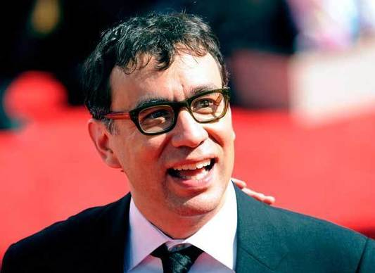 "Although Fred Armisen didn't appear as a cast member on any Chicago stages, he was part of the Chicago based band Trenchmouth. He was also a background drummer with Blue Man Group. Armisen was a cast member on ""Saturday Night Live"" from 2002 until 2013."