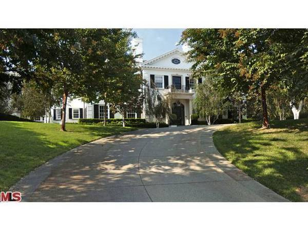 The stately two-story home of Paramount Chairman Brad Grey is reached by way of a sweeping driveway.