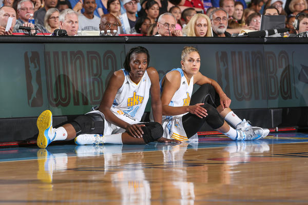 Sylvia Fowles (l) and Elena Delle Donne wait to go into a game against the New York Liberty.