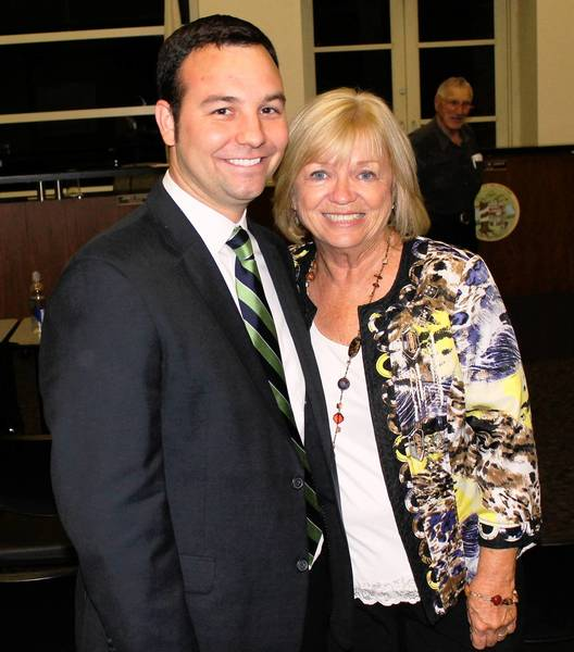 Dan Calandriello pauses with fellow Orland Park Trustee Patricia Gira at Monday's Village Board meeting after being confirmed to fill the post vacated by Brad O'Halloran.