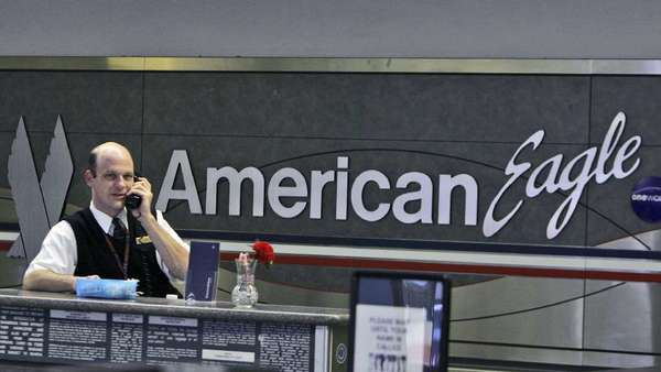 The 1,800 flight attendants for American Eagle oppose the proposed merger of American Airlines and US Airways, fearing their jobs are at risk because of a series of outsourcing plans announced since November.