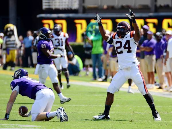 Rob Kinnan/USA TODAY Sports Photo Virginia Tech linebacker Tariq Edwards (24) celebrates a first half sack of East Carolina Pirates quarterback Shane Carden (5) on Saturday at Dowdy-Ficklen Stadium in Greenville, N.C.