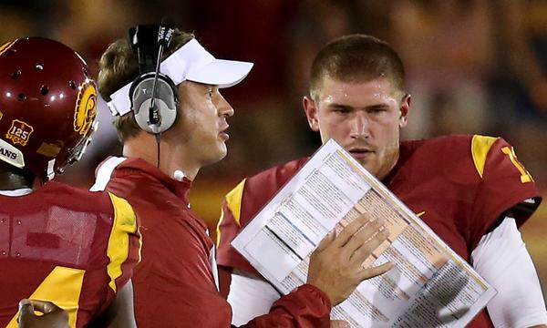 USC Coach Lane Kiffin isn't about to delegate offensive play-calling duties to one of his assistant coaches.