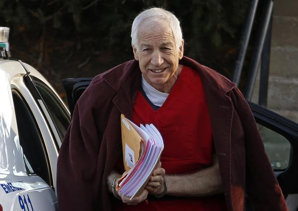 Former Penn State assistant football coach Jerry Sandusky arrives at the Centre County Courthouse for a post-sentencing hearing in January in Bellefonte, Pa. An attorney for Sandusky on Tuesday asked a three-judge appellate panel to grant him a new trial.