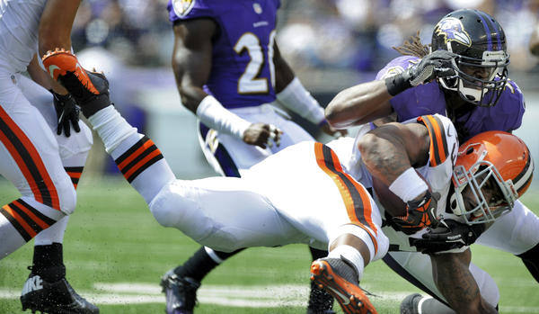 Ravens linebacker Josh Bynes tackles Browns running back Trent Richardson.