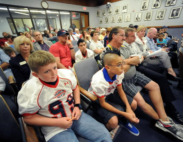 The Boca Raton City Council chambers were packed Tuesday night as the council opted to further review its decision to give the Boca Jets youth tackle football league Patch Reef Park for its practice field.