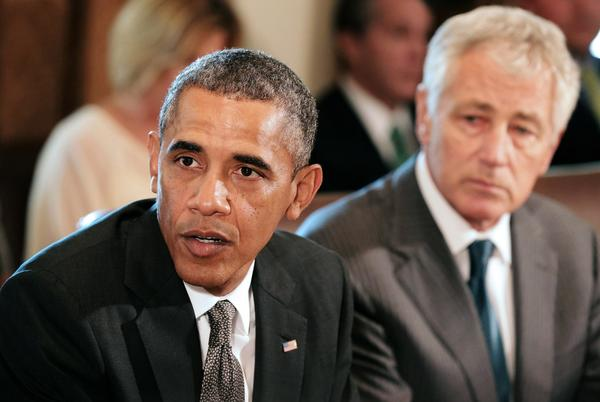 President Obama is seen during a cabinet meeting with Defense Secretary Chuck Hagel in the Cabinet Room of the White House.