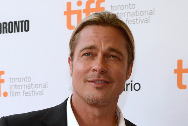 Brad Pitt posed for photos with newlyweds on their wedding day.