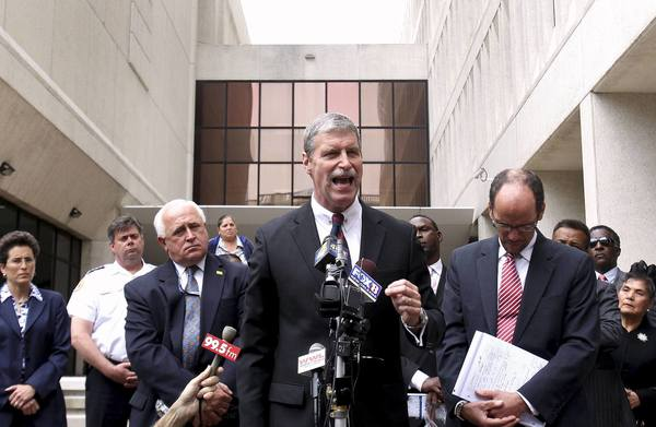 "U.S. Attorney Jim Letten (C) speaks to the media after the sentencing of former New Orleans police officers who were convicted in deadly shootings New Orleans in this April 4, 2012 file photo. A federal judge on September 17, 2013 ordered a new trial for New Orleans police officers convicted of killing civilians after Hurricane Katrina, denouncing the behavior of prosecutors he said compromised the case by posting ""vitriolic"" comments online."