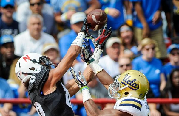 UCLA cornerback Fabian Moreau, right, can't stop Nebraska wide receiver Kenny Bell from catching a touchdown pass during the first half of the Bruins' 41-21 comeback victory Saturday.