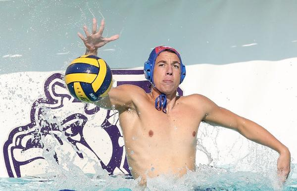 Burbank High boys' water polo goalie Derek Baer goes for a block in a 14-7 win over Flintridge Prep.