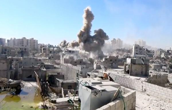 A video image from a citizen journalist shows shelling in Damascus' Barzeh suburb. A U.N. report confirming a poison gas attack on Damascus suburbs on Aug. 21 has sparked calls for holding Syrian President Bashar Assad accountable.