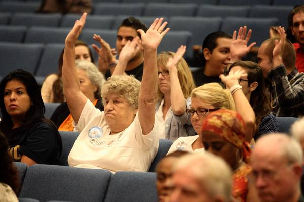 Jean Thaxton, center left, and other supporters of creating a permanent citizens commission to oversee the Sheriff's Department attend Tuesday's meeting of the L.A. County supervisors. The board postponed the vote on the proposal.