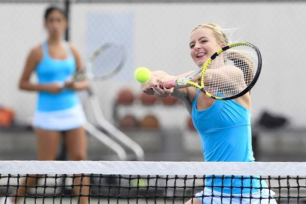 Corona del Mar High's Kenzie Purcifull, right, won twice with teammate Kimmia Naaseh, left, against Newport Harbor in the Battle of the Bay match on Tuesday.