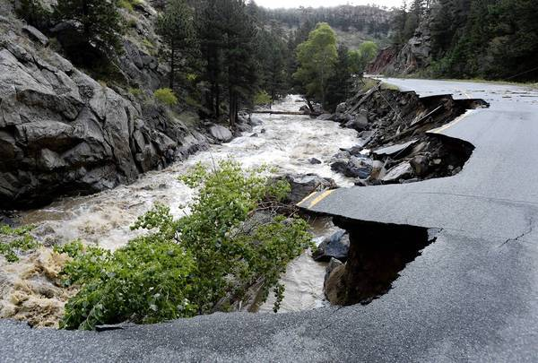 Rushing water has washed away a section of Lefthand Canyon Road near Olde Stage Road outside Boulder as Coloradans continue to contend with flooding that began last week.