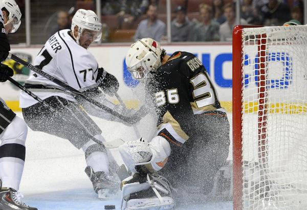 Kings forward Jeff Carter, left, scores on Ducks goalie John Gibson during the third period of the Kings' 6-0 preseason victory Tuesday.