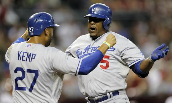 Dodgers third baseman Juan Uribe, right, is congratulated by teammate Matt Kemp after hitting a two-run home run in the first inning of the Dodgers' 9-3 win over the Arizona Diamondbacks on Tuesday night.
