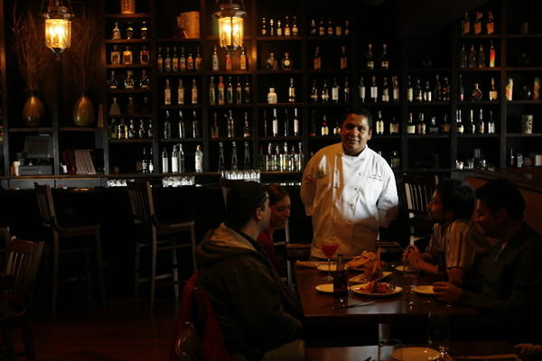 At the restaurant Zocalo in Chicago's River North area, executive chef Saul Roman, standing, poses at a table with Ricardo Sanchez, from left, Amy Gozdowiak, part owner Edgar Castaneda and Juan Lozano during lunch on November 20, 2006.