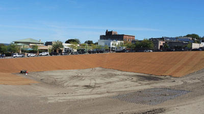 The former Petoskey Pointe construction site is seen Tuesday. The brown mats visible on the site's slopes help to hold new grass seed in place.