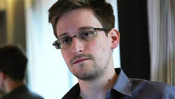 NSA whistleblower Edward Snowden, an analyst with a U.S. defense contractor, being interviewed by The Guardian in his hotel room in Hong Kong.