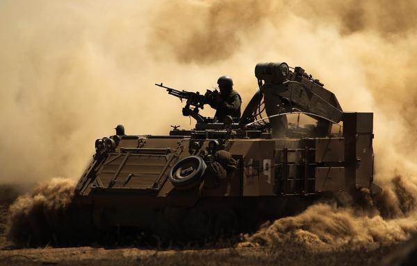 An Israeli soldier on top of his armored personnel carrier during training last week in the center of the Golan Heights, near the Israeli-Syrian border.