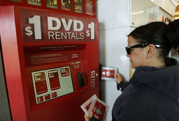 A customer returns DVDs at a Redbox kiosk in Santa Monica.