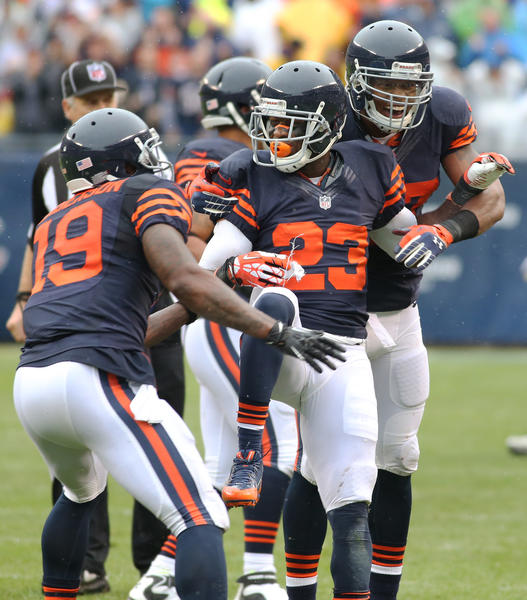 Devin Hester (23) is congratulated after a long kickoff return against the Vikings.