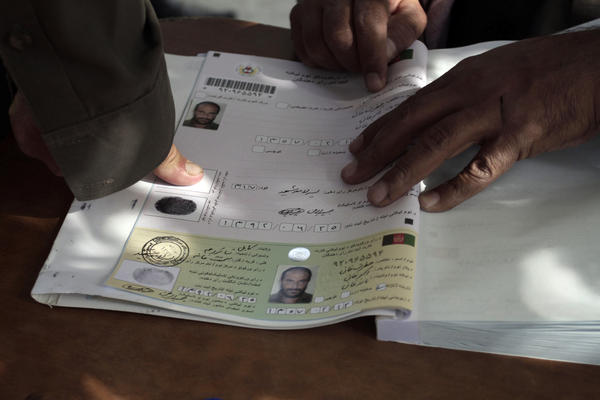 An Afghan man marks his voter registration application with his fingerprint in Kabul.