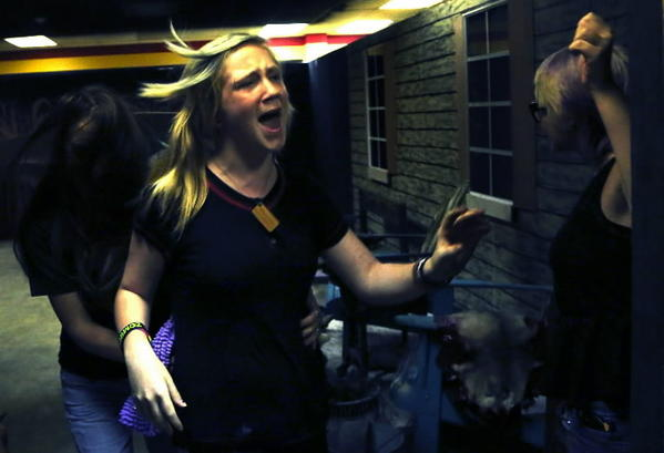 Maygen McKee, 14 runs screaming as she trains for the Enigma Haunt, haunted house in Boca Raton. MIke Stocker, Sun Sentinel