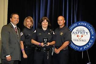 Jason Stubler, left, a Naperville police officer and judge of the Illinois Traffic Safety Challenge, joins Park Ridge police department members Julie Genualdi, Laura Kappler and Jason Leavitt in celebrating Park Ridge's third place finish in the challenge.