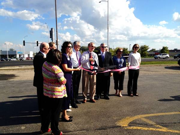 St. Charles Chamber of Commerce staff and city officials cut the ribbon commemorating the end of construction on Illinois Route 64.
